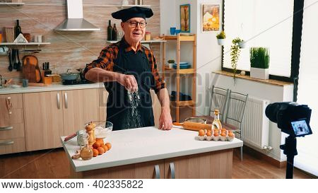 Baker Man Recording A Culinary Video Blog While Prepares Home Pizza. Retired Blogger Chef Influencer