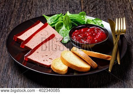 French Dish Duck Liver Pate With Cranberry Marmalade On Top Served On A Black Plate With Cranberry S