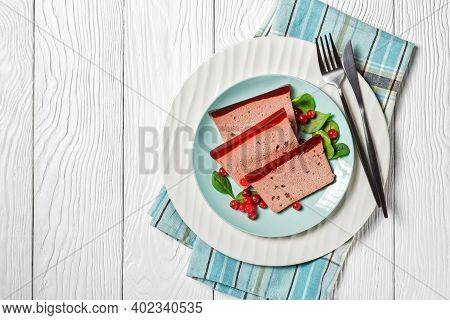 Duck Liver Pate Slices With Cranberry Jelly On Top: French Gourmet Food On A White Plate Served With
