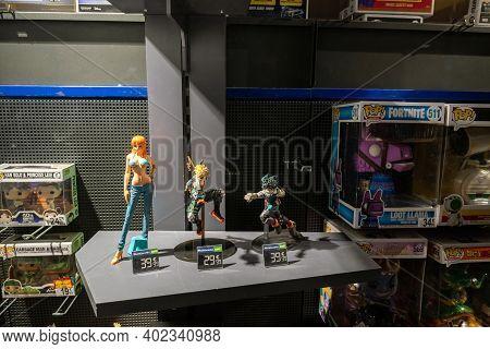Strasbourg, France - Jan 1, 2021: Figurines Cartoon Manga Characters On Sale In The Showcase Window