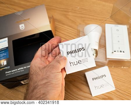 Paris, France - Dec 13, 2020: Pov Male Hand Unboxing Unpacking New Philips Signify Hue Smart Light F