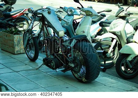 Crete, Greece - September 16, 2017: A Custom Made Motor Bike Parked In The Pavement On The Street. C