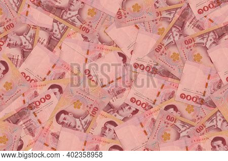 100 Thai Baht Bills Lies In Big Pile. Rich Life Conceptual Background. Big Amount Of Money