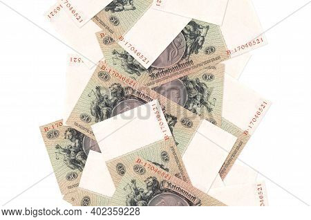 50 Reich Marks Bills Flying Down Isolated On White. Many Banknotes Falling With White Copy Space On