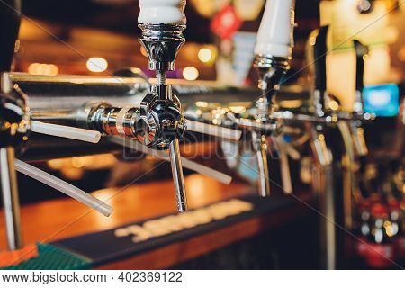 The Bar Counter With Bottles And Apparatus For Dispensing Beer. Apparatus For Dispensing Beer At The