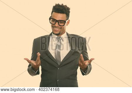Young Happy African Businessman Smiling While Looking Confused