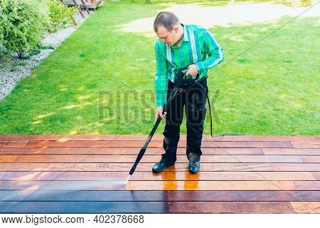 Power Washing - Man Cleaning Terrace With A Power Washer - High Water Pressure Cleaner On Terrace Su