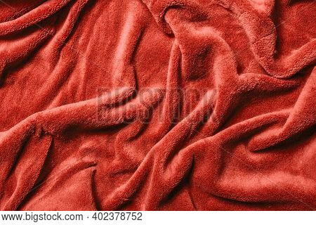 Soft Fabric Background. Red Blanket Texture. Wave Material Pattern. Decorative Curtain Textile Backg