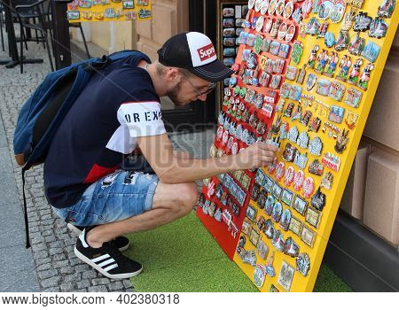 Warsaw / Poland. 27 July 2019: Modern Guy Buying Souvenir At Souvenir Shop In Warsaw. Keepsake Magne