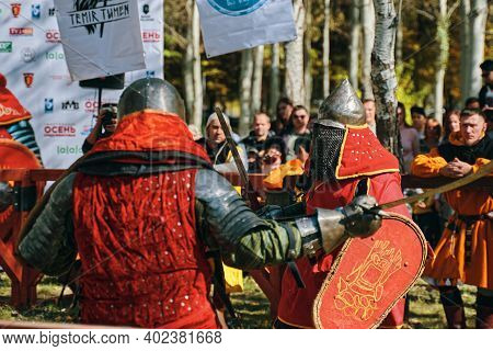 Imitation Of Medieval Battles During The Festival Of Historical Clubs. Reconstruction Of Knightly Ba