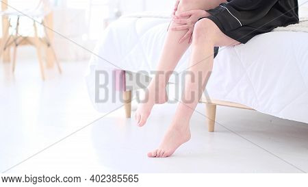 Tender Woman Touch Her Smooth And Soft Skin On Legs, Enjoy Beauty Procedures. Young Asian Woman Appl