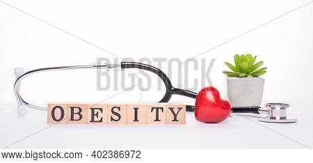 Obesity Concept. Panoramic Banner Close Up View Photo Of Stethoscope Heart And Wooden Blocks Making