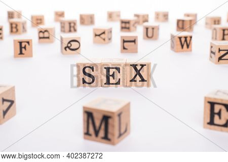 Sex Concept. Close Up View Photo Of Wooden Cubes Letters Showing Making Word Sex Isolated White Desk