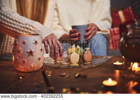 Woman With Daughter Eating Cookies For Christmas Supper