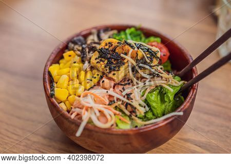 Raw Organic Poke Bowl With Rice And Veggies Close-up On The Table. Top View From Above Horizontal
