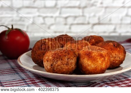 Delicious Hot Italian Arancini - Rice Balls Stuffed With Cheese In A Plate On An Old Wooden Table