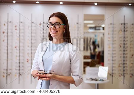 Gladsome Eye Care Specialist Having Glasses On Her Hand
