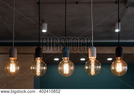 Decorative Antique Edison Style Light Bulbs. Set Of Different Vintage Glowing Light Bulbs In Loft In
