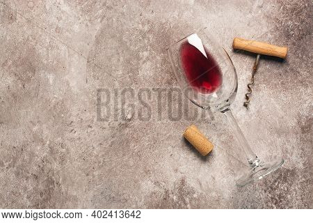 Flat Lay Glass Of Red Wine, Corkscrew And Cork. Beige Grunge Background. Wine Degustation Concept. T