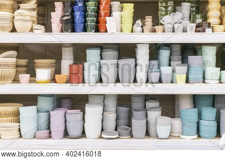 Colorful Flower Pots On The Shelves Of The Store . For The Entire Frame