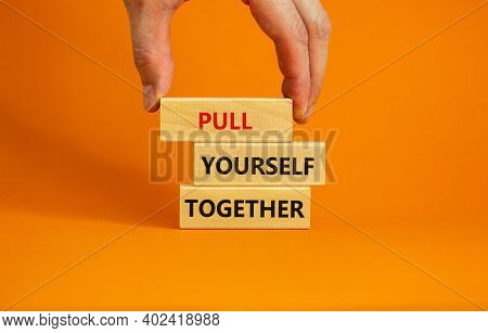 Pull Yourself Together Symbol. Wooden Blocks With Words 'pull Yourself Together'. Beautiful Orange B