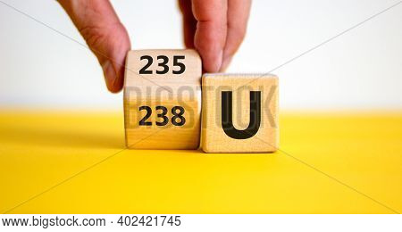 Uranium Enrichment Symbol. Hand Turns The Cube And Changes The Word '238 U' To '235 U'. Beautiful Ye