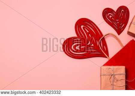 Love Shopping Concept. Sale. Paper Red Bag And Gifts On A Pink Background. Eco Friendly Gift Wrap Fo
