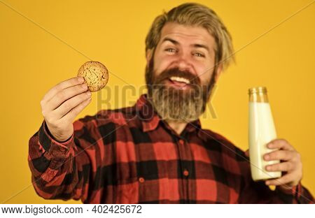 Milk And Sweet Cookie. Delicious As In Childhood. Mature Bearded Man Drink Milk With Cookie. Breakfa