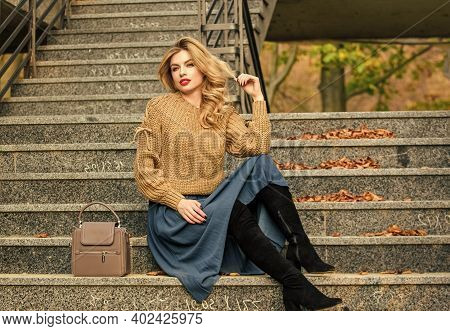 Layer Oversize Knit Over Girly Skirt. Fall Outfit Formula. How To Style Sweater And Skirt Combo For