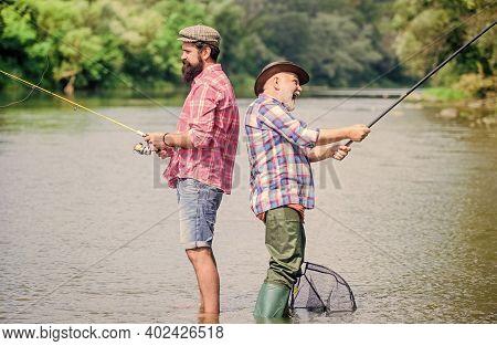 Father And Son Fishing. Fisherman Fishing Equipment. Fisherman Grandpa And Mature Man Friends. Fishe