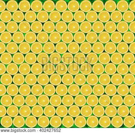 Texture Of Lemon Slices. Yellow Texture Of Sliced Lemon Slices. Slices Of Fresh Juicy Yellow Lemons.