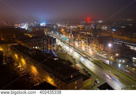 Gdansk, Poland - January 1, 2021: Amazing cityscape of Gdansk city with main railway station at dusk, Poland