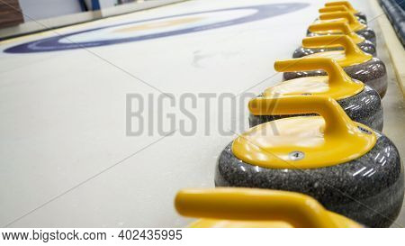 Granite Stones For Curling On White Ice Close-up.winter Sport, Team Game.curling Club