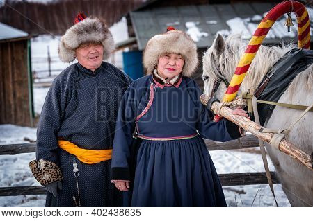 Naryn-atsagat Zone, Near Oulan Oude (ulan Ude), Siberia, Russia - Mars 09, 2020 : Couple Of Buryats