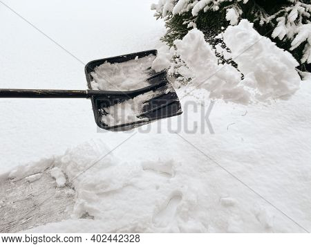 Somebody Is Throwing Snow With A Plastic Shovel, Snow Removal Tool, Shoveler Cleaning Snow Out Of A