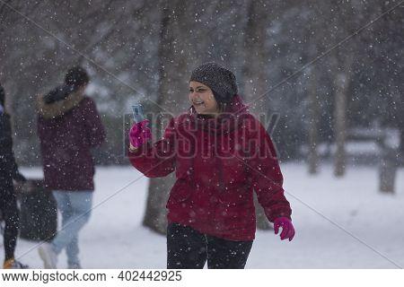 Madrid, Spain - January 08, 2021: Girl Taking Photos In The Buen Retiro Park In Madrid, In The Middl