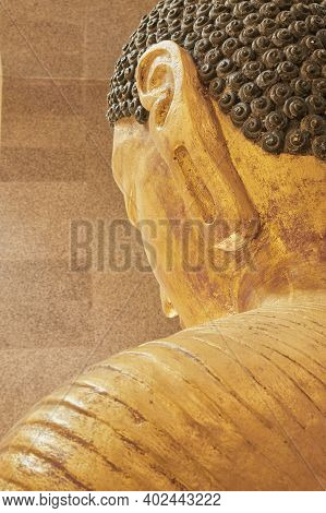 Phayao, Thailand - Dec 6, 2020: Portrait Back Of Gold Buddha Reclining Statue With Natural Light