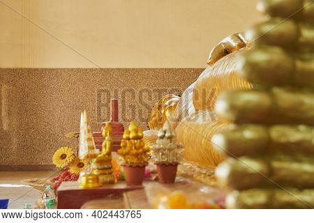 Phayao, Thailand - Dec 6, 2020: Blurring Foot Foreground Of Gold Buddha Reclining Statue In Sanctuar
