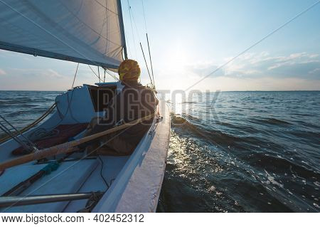 A Man On A Sailing Boat, Travels In The Sunlight On A Yacht, A Man On A Sailing Yacht At Sunset, A S