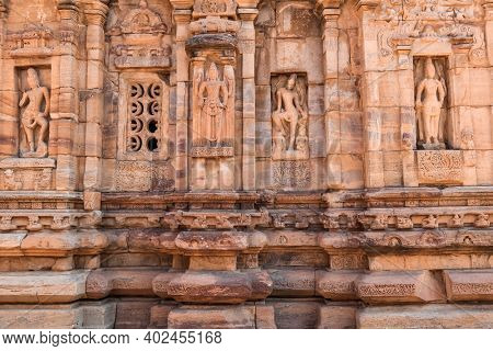 Ancient sculptures on iconic rock temples of Pattadakal, Karnataka, India.