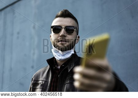 Cool Man With Yellow Cellphone Wearing Open Face Protective Mask During Coronavirus Outbreak - Hipst