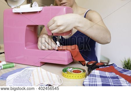 Caucasian Female Hands Working With Sewing Machine Making Face Medical Mask For Preventing And Stop
