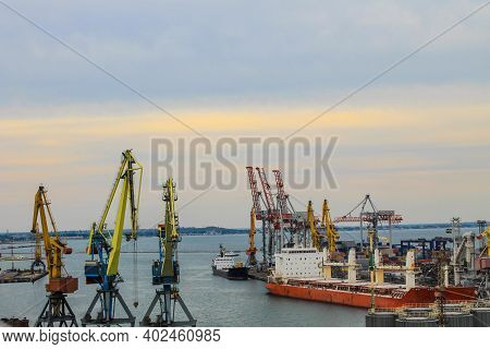 Hoisting Cranes And Industrial Ships At Cargo Sea Port In Odessa, Ukraine