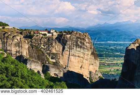 Evening View Of Monastery Of Holy Trinity Or Agia Triada And Rocky Pillars. Meteora, Greece, Valley,