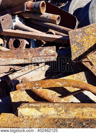 Heap Of The Scrap Iron. Pile Of Secondary Raw Materials. Iron Raw Materials Ready For Recycling. Col
