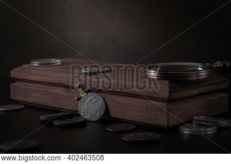 Numismatics. Old Collectible Coins Of Silver, Gold And Copper On The Table.  A Collector In Special