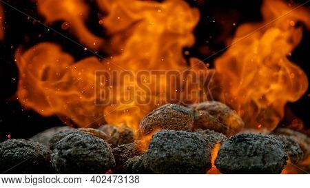 Charcoal briquettes ready for barbecue grill, close-up.