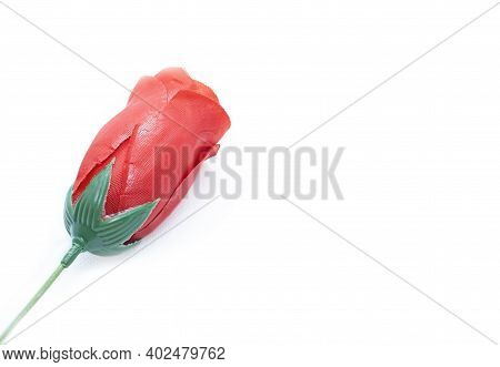 Red Plastic Rose On White Background, Can Be Used For Weddings, Mother's Day, Women's Day,