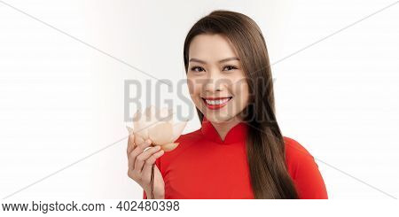 Portrait Woman Wearing Ao Dai Vietnam Traditional Dress Holding Lotus Flower Smiling And Happiness.