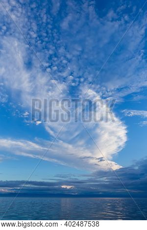Blue Sky With White Picturesque Clouds And Mountains